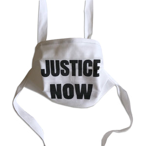 "cotton face mask that says ""Justice Now"""
