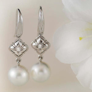 Diamond and Pearl Drop Earrings in White Gold
