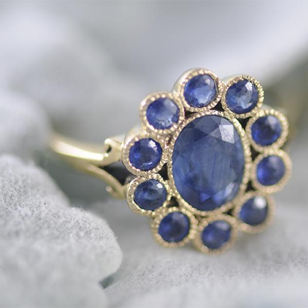 Sapphire Halo Ring Bezel Set in 9k Yellow Gold