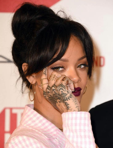 Rihanna in Lady Grey jewelry rings by Jill Martinelli and Sabine Le Guyader