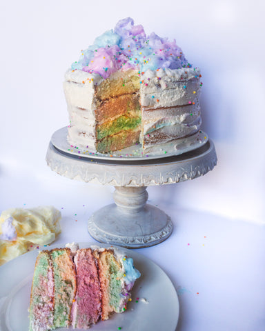 Cotton Candy Layered Cake with slice on a plate in front