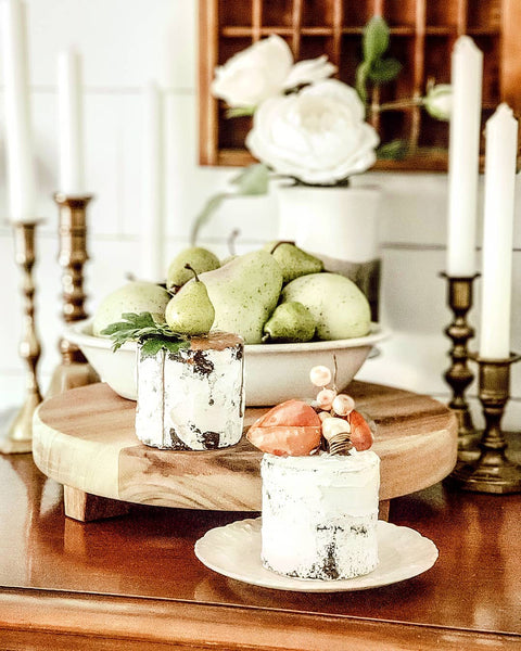 taper candles and faux cakes in vignette