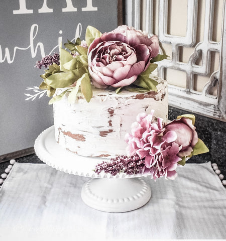Faux Cake with spring pink flowers on cake stand