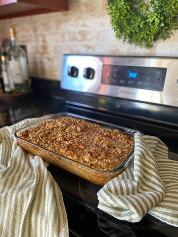 Baked oatmeal on stove with kitchen towels