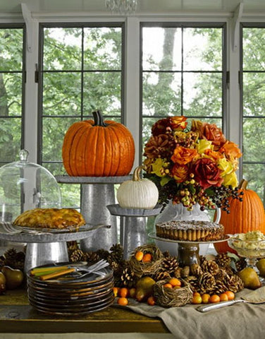 Autumn Table Display With Pumpkins and Desserts
