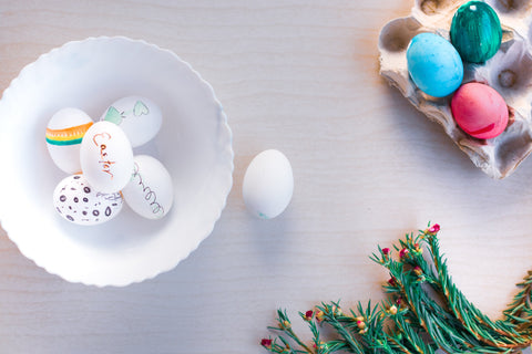 Easter Eggs in white bowl with egg carton