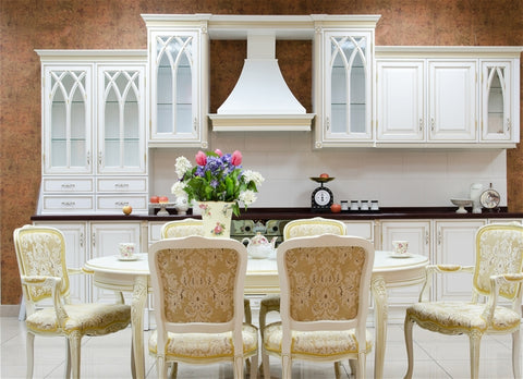 neutral colored kitchen with flowers on the table