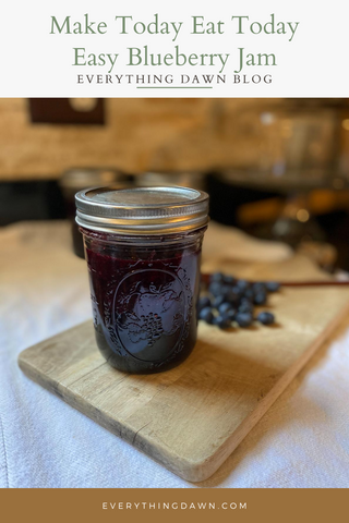 pin blueberry jam on wooden cutting board with blueberries - how to make easy blueberry jam