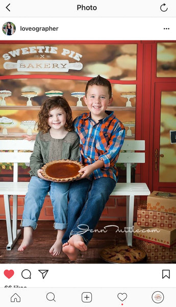 two children sitting on a bench in front of a bakery with an Everything Dawn Bakery Candles Fake Pumpkin Pie