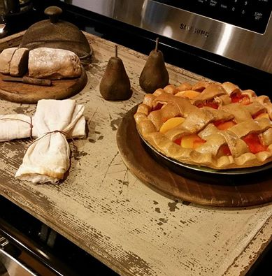 fake peach pie on kitchen stove