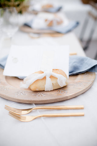 Faux Bread on table place setting with note card and gold utensils