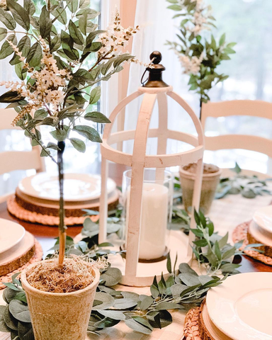 spring tablescape with topiaries and candles