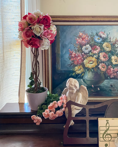 Flower painting with pink rose topiary and statue on piano