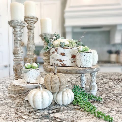 faux cakes with pumpkins and greenery