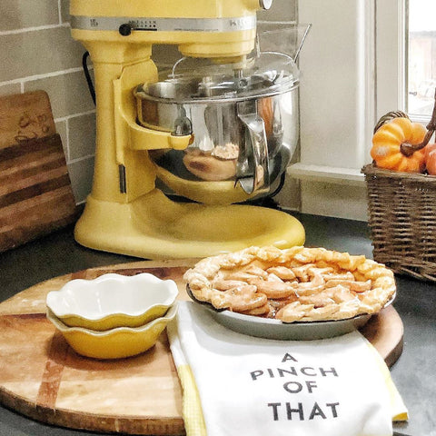 faux apple pie on counter beside mixer with hand towels
