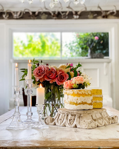Faux Cake on table with red roses