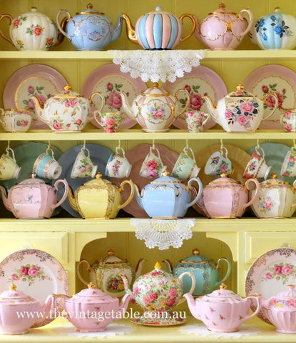 mixed tea display on yellow shelving - whimsical kitchen focal point