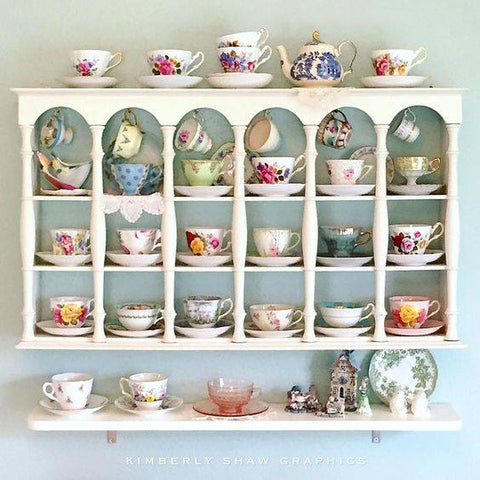 tea china on white wall shelf