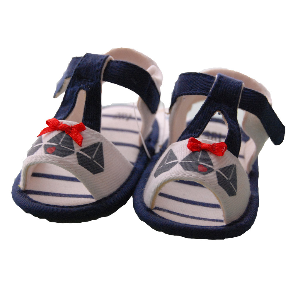 Sandal from the Tuc Tuc girl accessories line. Front band with boat motif   and bow. Velcro cl...