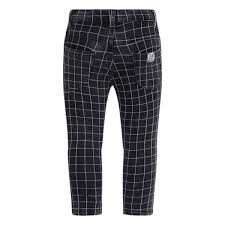 Trousers from the Tuc Tuc children's clothing line, with patches on the knees and checked pattern...