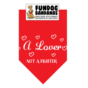 Red one size fits most dog bandana with A Lover Not a Fighter in white ink.