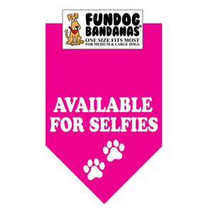 Hot Pink one size fits most dog bandana with Available for Selfies and two paws in white ink.