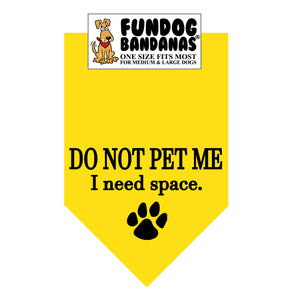 Gold one size fits most dog bandana with Do Not Pet Me I Need Space in black ink.