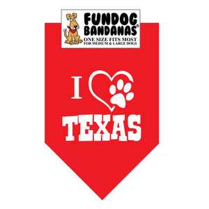 Red one size fits most dog bandana with I Love Texas and a paw within a heart in white ink.