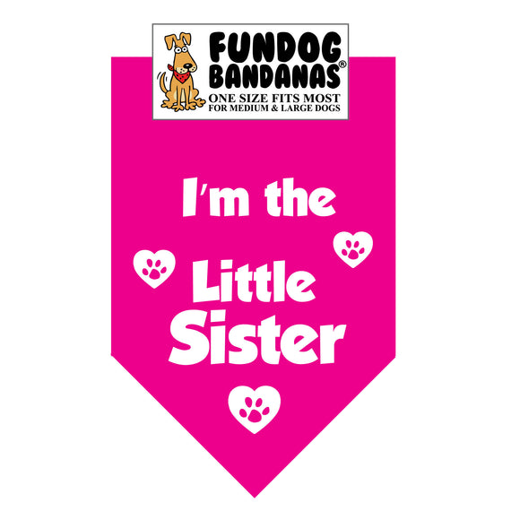 Hot Pink one size fits most dog bandana with I'm the Little Sister and paws within hearts in white ink.