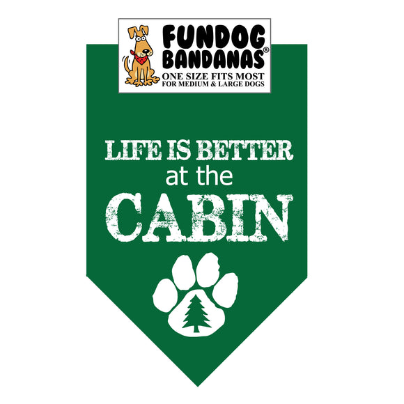 Forest Green one size fits most dog bandana with Life Is Better At The Cabin and a pine tree within a paw in white ink.
