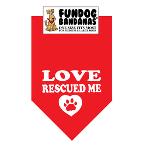 Red one size fits most dog bandana with Love Rescued Me and a paw within a heart in white ink.