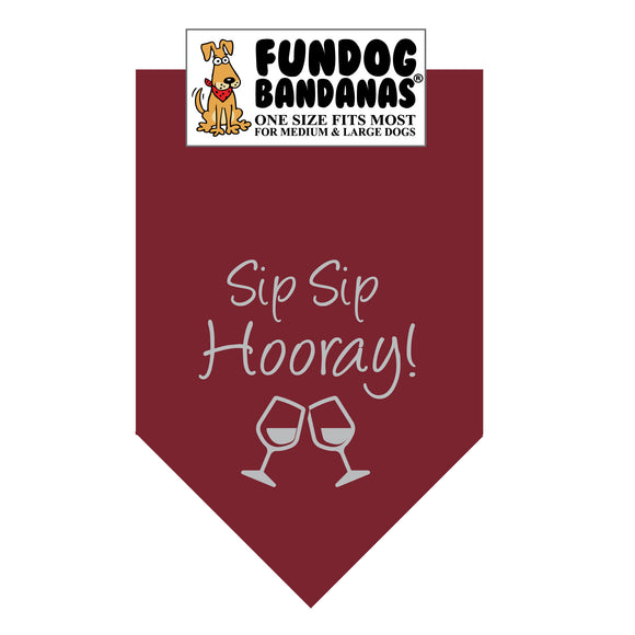 Burgundy one size fits most dog bandana with Sip Sip Hooray and 2 wine glasses in light gray ink.