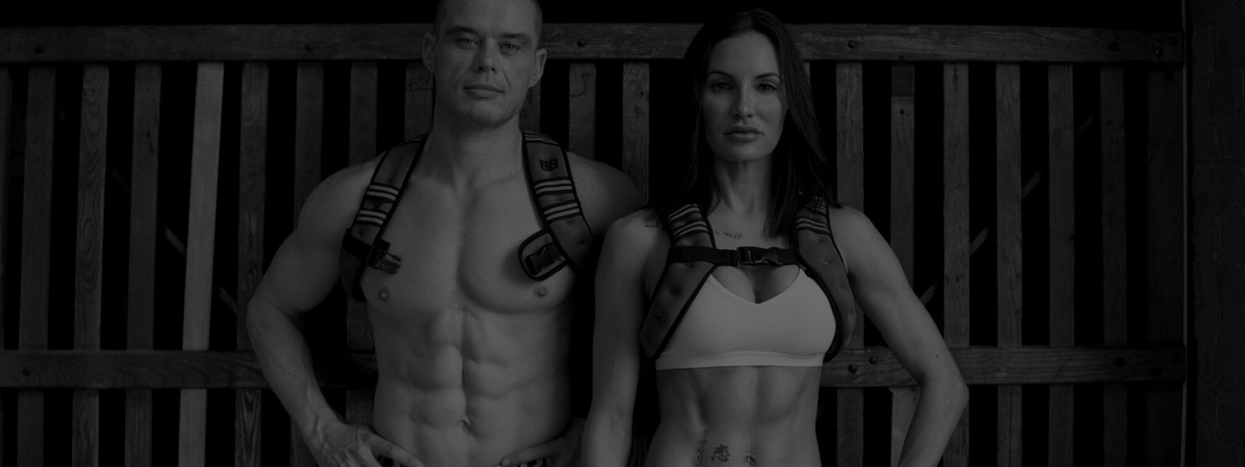 Black and White Image of Bodyrock Host Trainer Sean Light and Model Trainer Lisa Marie wearing Bodyrock weighted Vest