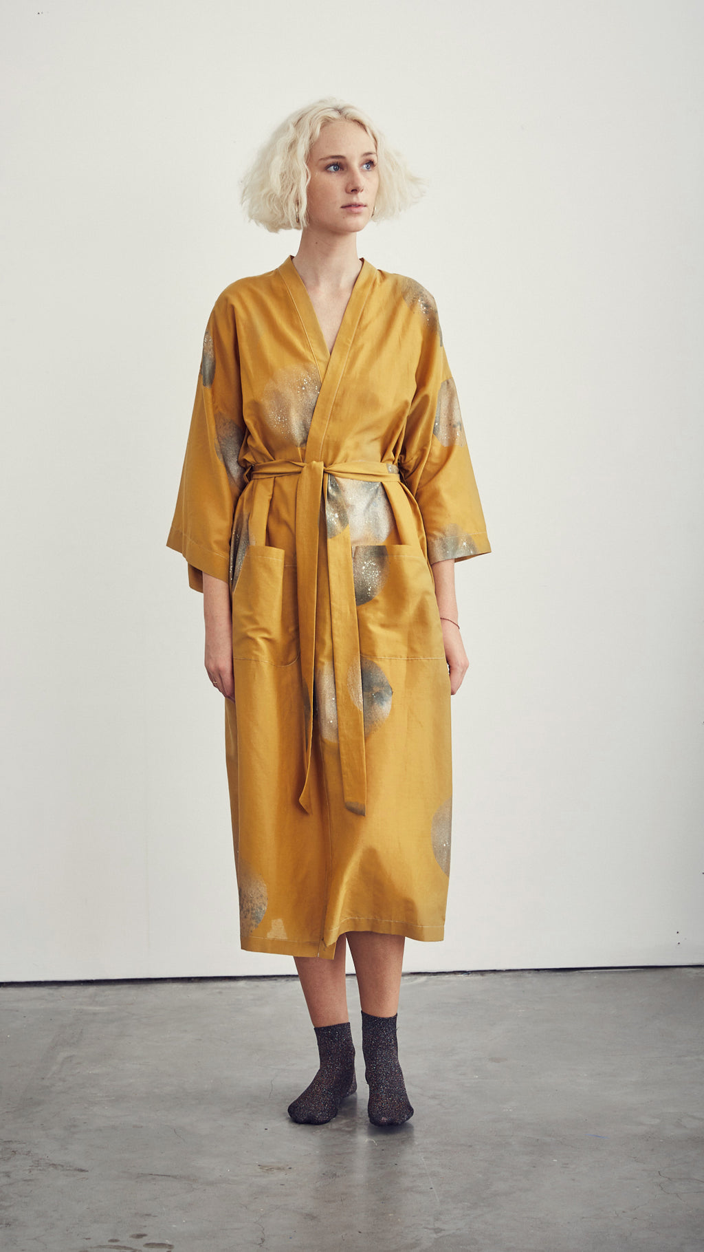 ROBE / silver suns on ochre