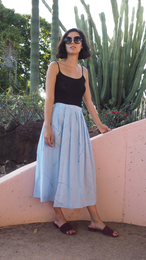 wrap skirt / blue grass / sky