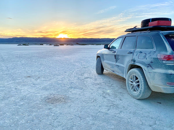 Jeep with Falken Wildpeak A/T3W tires in desert at sunset.