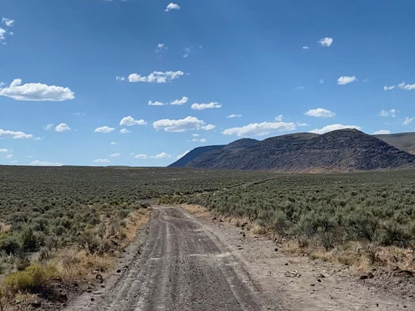 Remote desert trail with beautiful blue sky and surreal scenery.