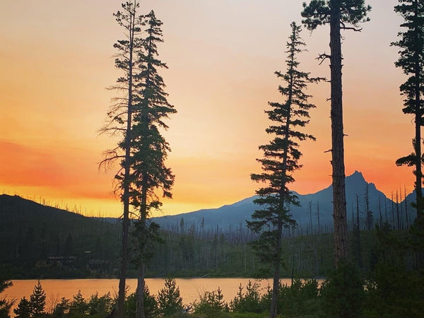 West coast wildfire red sky in Oregon near a secluded lake.