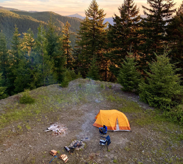 Camping with a tent and campfire at a beautiful secluded camping spot.