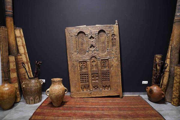 brown Antique Moroccan Door with vintage features, at an art gallery