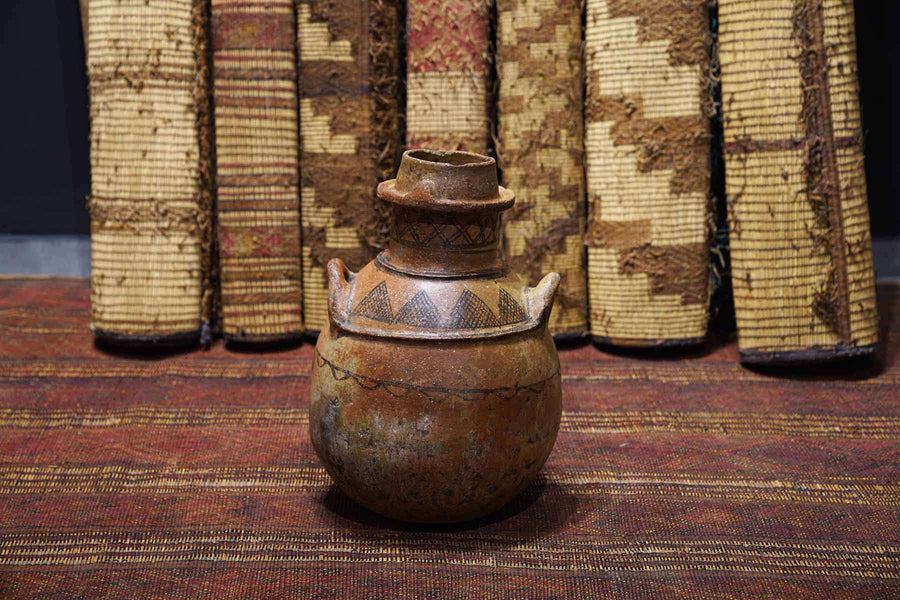 Antique Moroccan Pot on display at a Gallery.