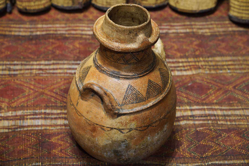 brown and patterned Antique Moroccan Pot at an art gallery