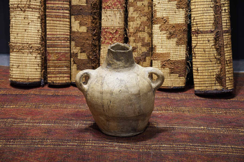 Moroccan Antique Pot on display at a gallery