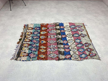 beige and brown Zanafi Kilim Rug with different patterns and a diamond shape on its centre