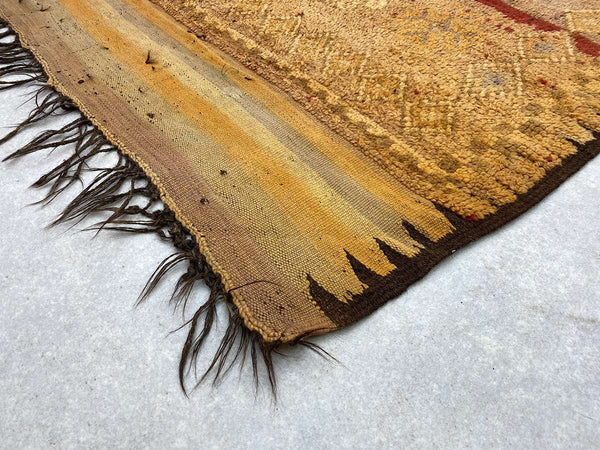 a fringed Zanafi Kilim Rug with a grey texture and beige patterns