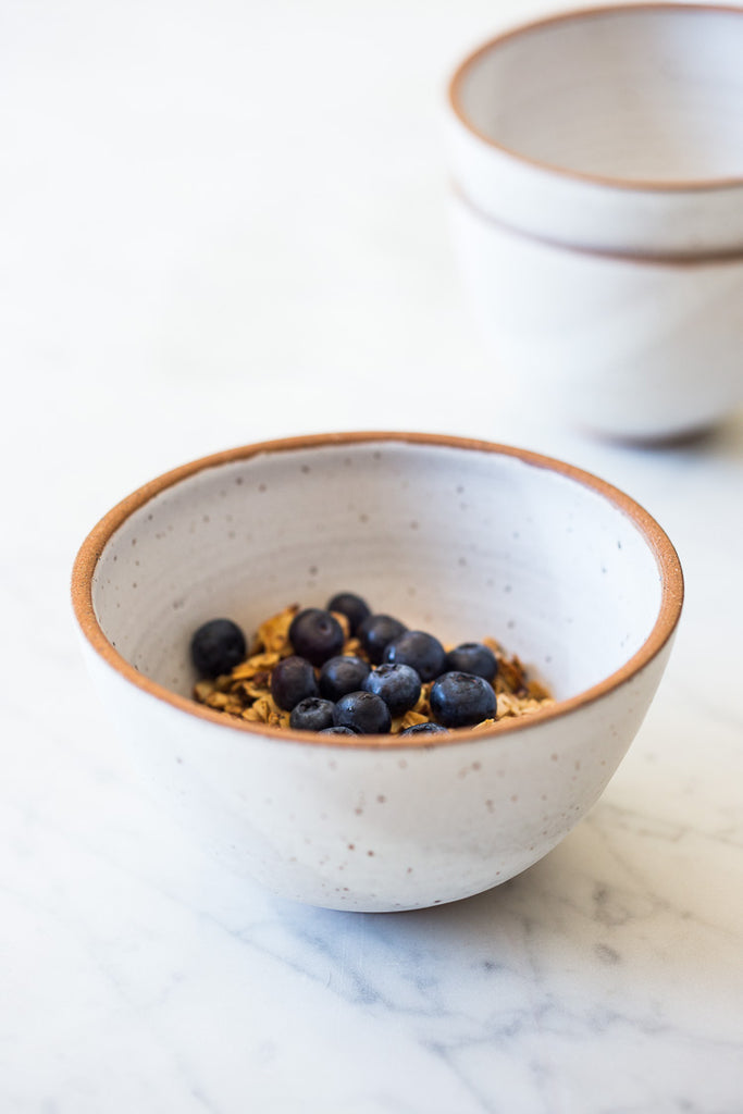 handmade earthenware bowls with matte white speckled glaze #pottery #ceramics #whitekitchen