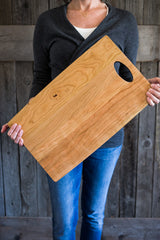 Cherry Wood serving boards with burnished edges and handle. Made in the USA. #woodboard#servingboard