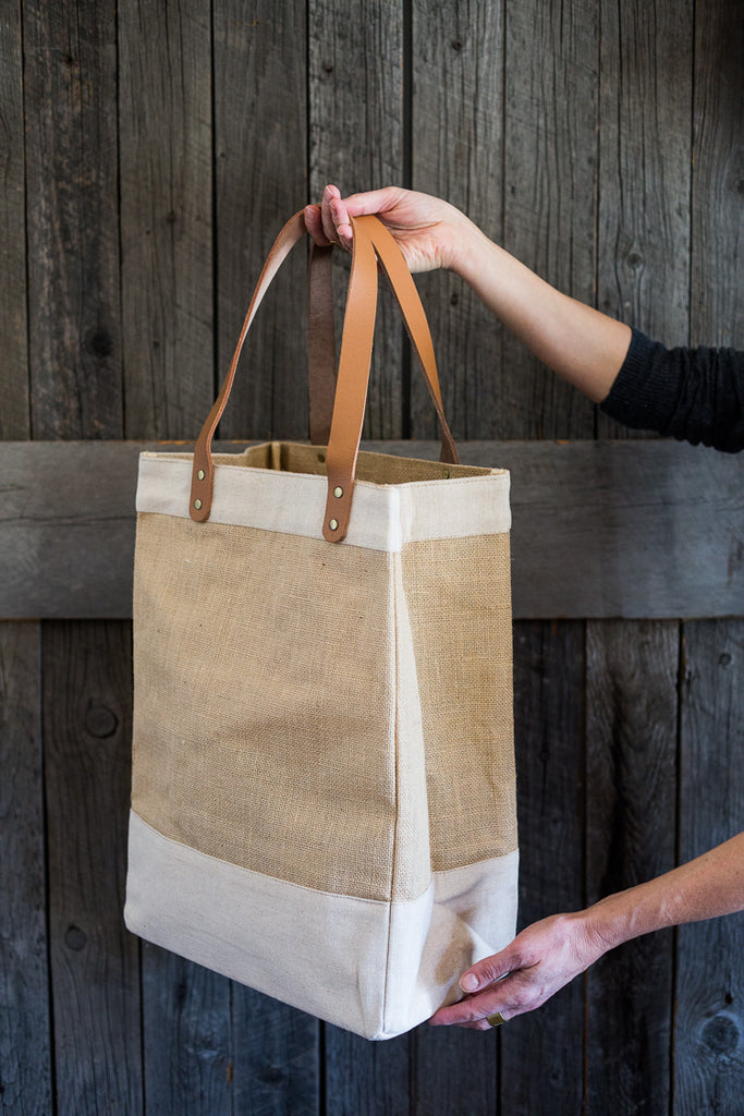 Natural jute and canvas market tote with leather handles, brass rivets, interior pocket #tote