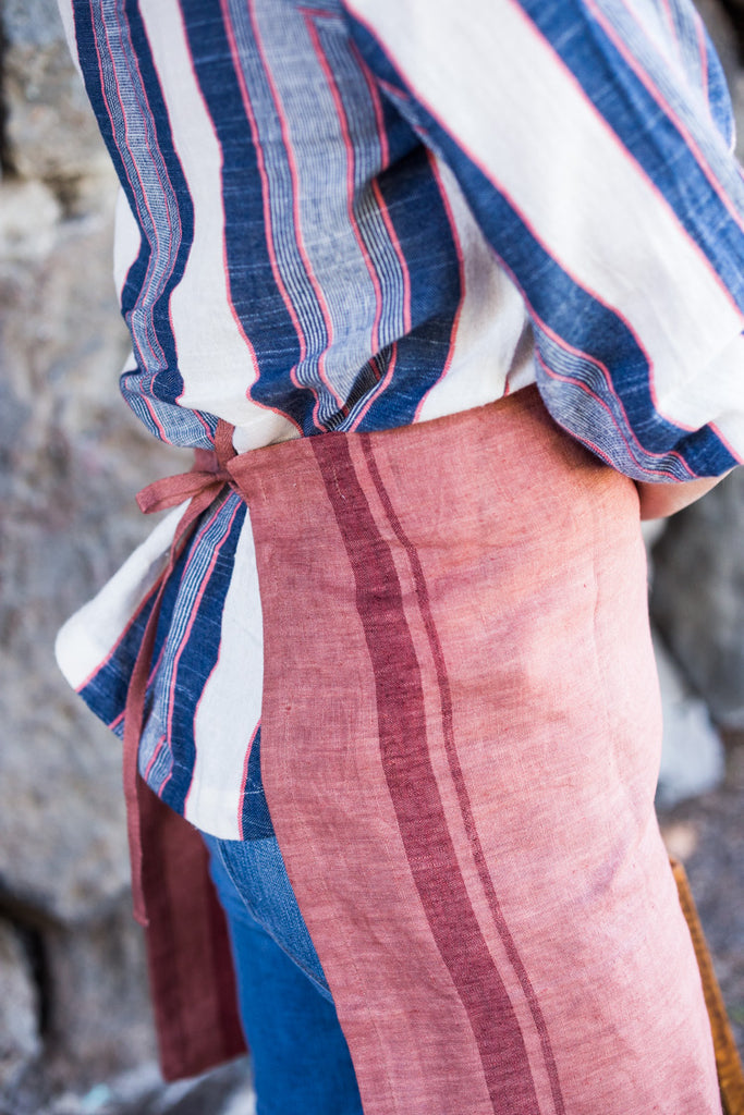 Salmon colored 100% linen towel doubles as an apron #linenapron #apron
