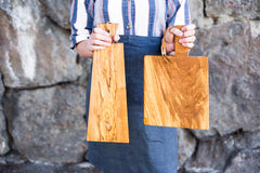 Olive wood cutting or serving board with modern design, leather and brass ties #olivewood